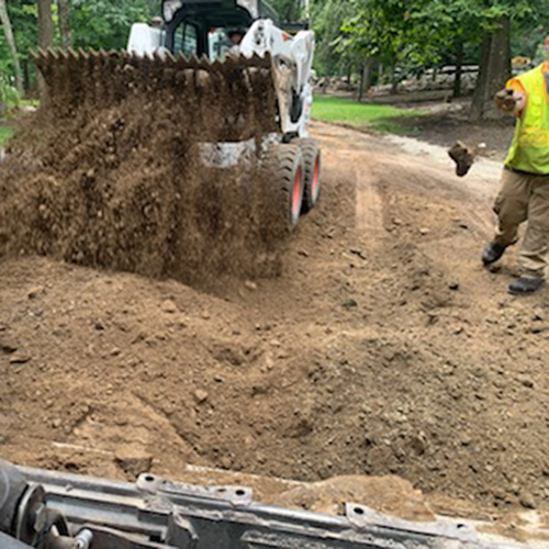 Ripping out and replacing asphalt driveway in Derry NH